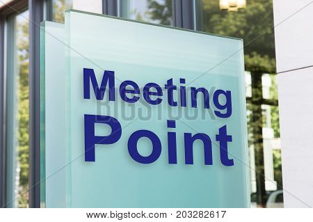 Closeup of meeting point on glass board outside building in city