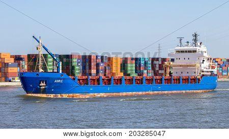 ANTWERP BELGIUM - JUL 9 2013: Container ship entering the Port of Antwerp.