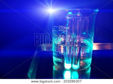 Chemical experiment glass beaker. Glass flask filled with transparent liquid. Clinical analysis. Medical research. chemical experiment concept image. Natural science education. Chemistry lesson