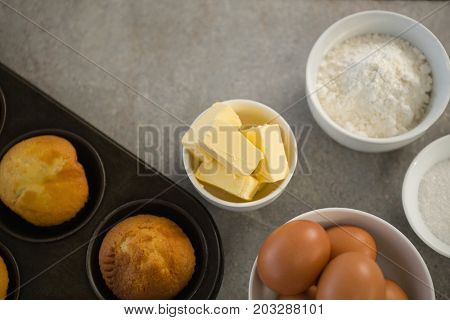Close up Ingredients by muffin tin on table