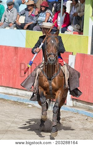 June 18 2017 Pujili Ecuador: bullfighter on horseback holding a spear is getting ready for the ritual fight in the arena
