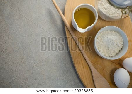 Overhead view of ingredients on cutting board at table