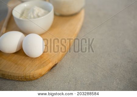Baking ingredients on cutting board at table