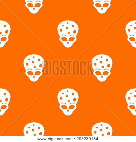 Extraterrestrial alien head pattern repeat seamless in orange color for any design. Vector geometric illustration