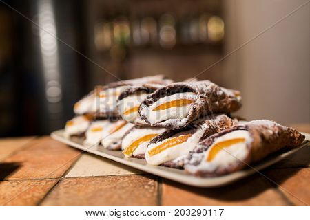 food, cooking and baking concept - pastry on plate at bakery