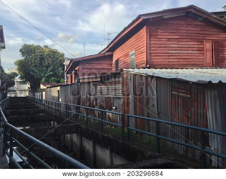 slum home and walking street canal in bankgok city Thailand