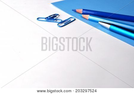Blue and white background  with dark blue pencils and copy space