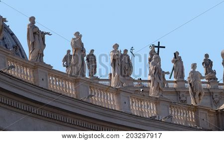 ROME, ITALY - SEPTEMBER 02: Gallery of saints, fragment of colonnade of St. Peters Basilica - the world largest church, is the center of Christianity in Rome, Italy on September 02, 2016.