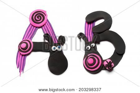 Plasticine letters A and B. Color plasticine alphabet, isolated on white background. Pink and black color of the alphabet. Emo style