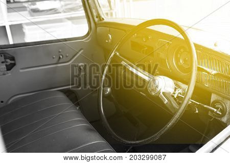 Interior of classic vintage car.The interior in a convertible retro car. dashboard in interior of old classic automobile.