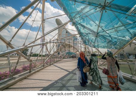 Muslim Women On Helix Bridge In Marina Bay, Singapore