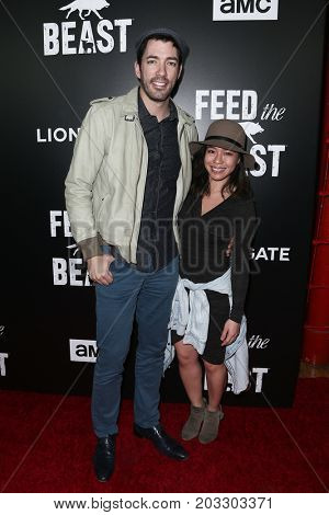 NEW YORK - MAY 23: Drew Scott (L) and Linda Phan attend the AMC's 'Feed The Beast' premiere on May 23, 2016 in New York City.