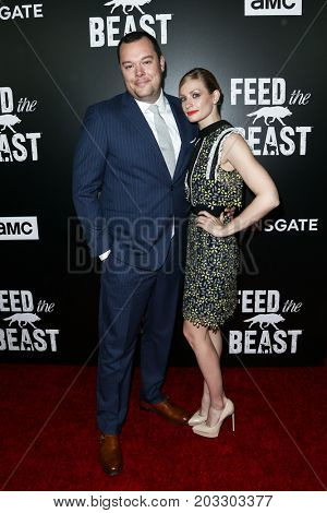 NEW YORK - MAY 23: Michael Gladis (L) and Beth Behrs attend the AMC's 'Feed The Beast' premiere on May 23, 2016 in New York City.