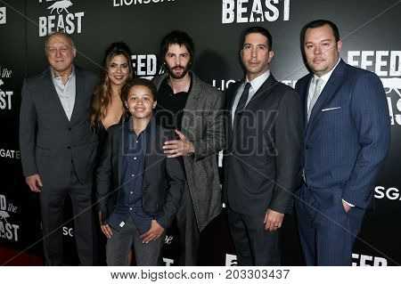 NEW YORK - MAY 23: (L-R) John Doman, Lorenza Izzo, Elijah Jacob, Jim Sturgess, David Schwimmer and Michael Gladis attend the AMC's 'Feed The Beast' premiere on May 23, 2016 in New York City.