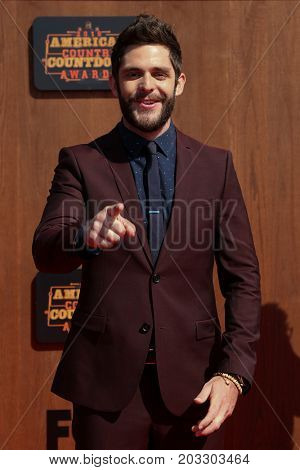 INGLEWOOD, CA - MAY 01: Singer Thomas Rhett attends the 2016 American Country Countdown Awards at The Forum on May 01, 2016 in Inglewood, California.