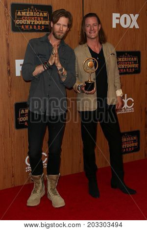 INGLEWOOD, CA - MAY 01: Singers Brian Kelley (L) and Tyler Hubbard of Florida Georgia Line attend the 2016 American Country Countdown Awards at The Forum on May 01, 2016 in Inglewood, California.