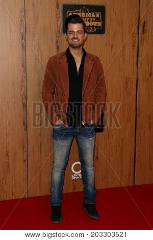 INGLEWOOD, CA - MAY 01: Singer Chase Bryant poses in the press room at the 2016 American Country Countdown Awards at The Forum on May 01, 2016 in Inglewood, California.