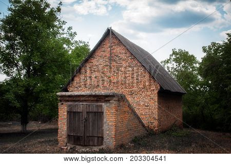 old brick house with a cellar in the Chernobyl zone