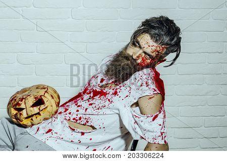 Halloween Maniac And Bloody Jack O Lantern