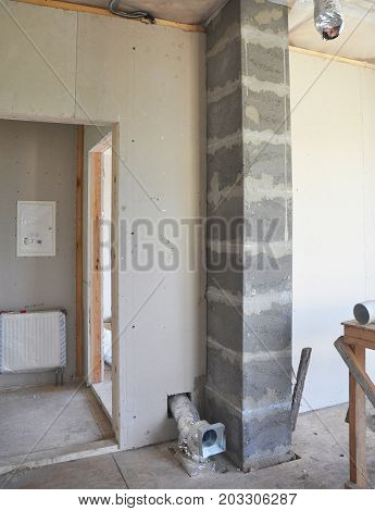 Building new modular chimney from pumice stone blocks inside room with ventilation system