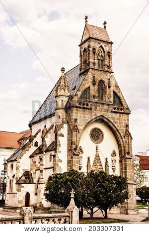 St. Michael chapel in Kosice Slovak republic. Architectural scene. Yellow photo filter. Vertical composition.