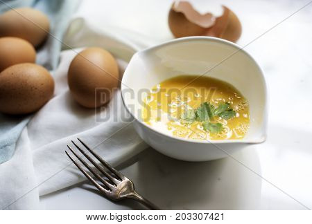 Closeup of beated eggs preparing to be cooked