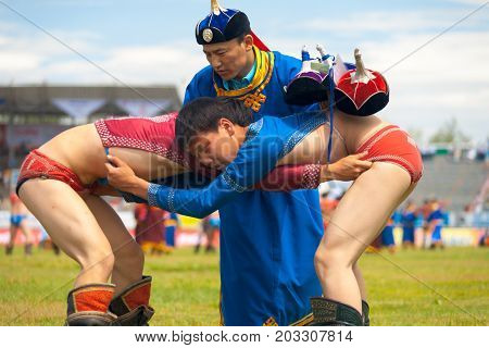 Naadam Festival Referee Checking Wrestling Boys