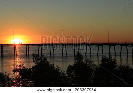 sun setting behind the wharf, Derby, Western Australia.