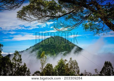 Landscape of mountains amount fog in Kawah Ijen volcano Java Indonesia.