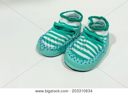 Green Stripe Fabric Shoe With Leather Zig Zag Stitched Along The Edge.