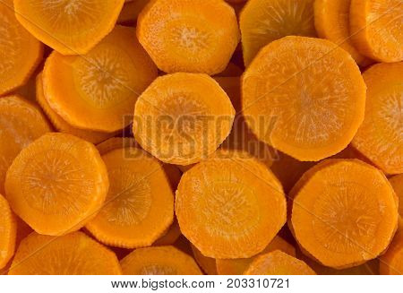Fresh raw peeled carrot slices. Food background