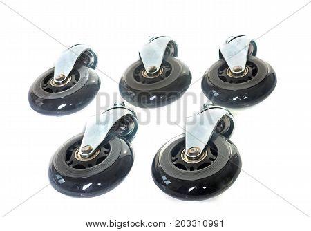 Furniture caster wheel in front of white background