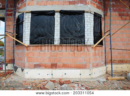 Prepare to Protect Unfinished House Windows for Winter to Avoid Snow and Rain Inside. Reduce Condensation in Unfinished Building