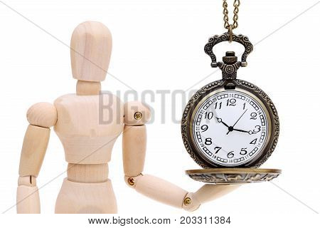 wooden model dummy hand holding ancient clock watch isolated on white background