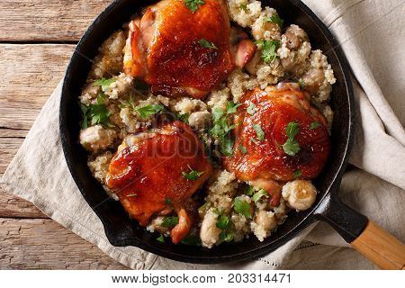 Tasty Fried Chicken Thighs With A Quinoa And Mushrooms Close-up. Horizontal Top View
