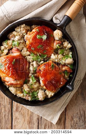 Tasty Fried Chicken Thighs With A Quinoa And Mushrooms Close-up. Vertical Top View