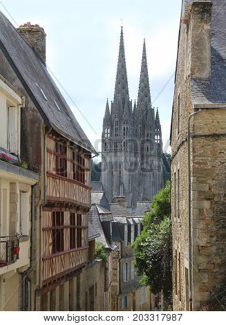 QUIMPER, FRANCE, JULY 24 2017:The quaint streets of old town Quimper and Saint-Corentin, Cathedral.  Quimper is a historic town in Finistere and a popular tourist destination in Brittany.
