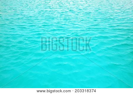 Turquoise clear water in the swimming pool - abstract background