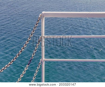 White ferry fence and blue sea at the sea