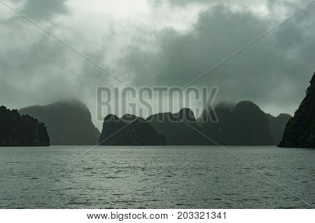 Silhouettes Of Karst Islands Of Halong Bay In Mist