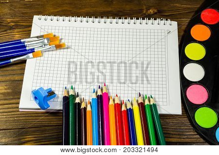 Set Of Drawing Tools On Wooden Background