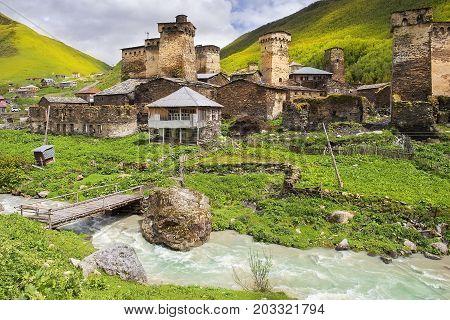 turbulent water flow in Ushguli - the highest inhabited village in Europe, Enguri gorge in Upper Svaneti, Georgia - UNESCO World Heritage Site poster