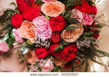 Bouquet of pion-shaped roses. Wedding decor. Close up shot