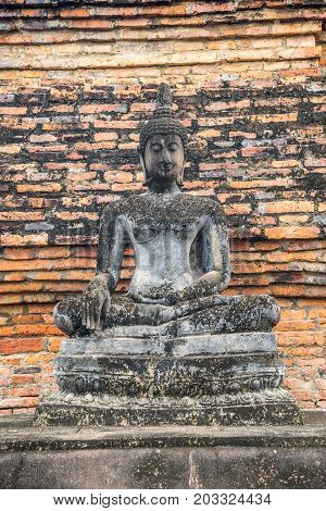 Old and ancient Buddha Image in Sukhothai historical park Unesco world heritage in Sukhothai Thailand
