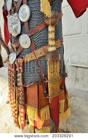 Roman warrior iron armor and sword, close up