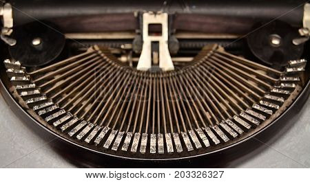 the mechanical typebars of an obsolete typewriter