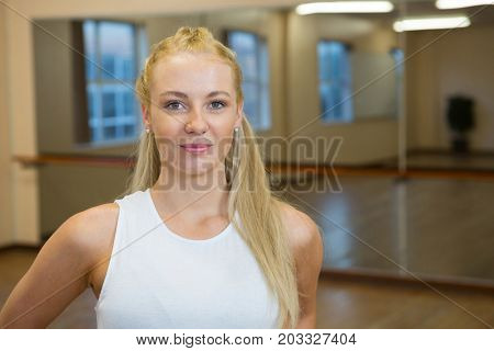 Portrait of beautiful female dancer standing at studio