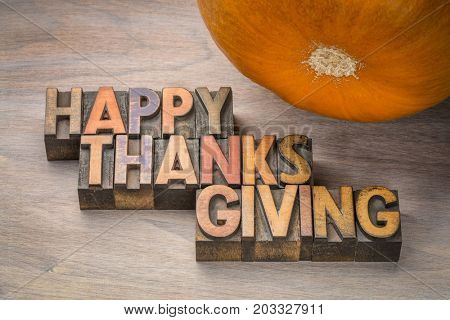 Happy Thanksgiving greeting card - typography in vintage letterpress wood type with a pumpkin