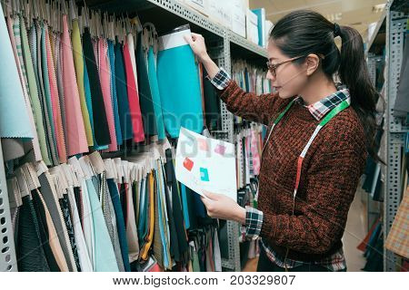 Woman Designer Choosing Clothing Sample Drapery