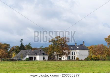DENEKAMP NETHERLANDS - NOVEMBER 2 2016: Singraven mansion with neoclassical frontage in a rural surrounding